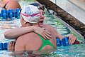 Missy Franklin hugs Allison Schmidt after winning 200m freestyle (8993130110).jpg