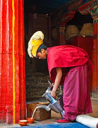Butter tea - A monk pours butter tea in Tashilhunpo Monastery, Tibet