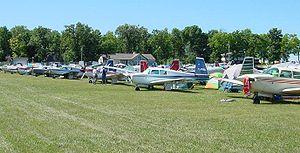 Mooney M20 - Mooney M20s gathered at the 2002 Mooney Caravan to AirVenture, Oshkosh, Wisconsin