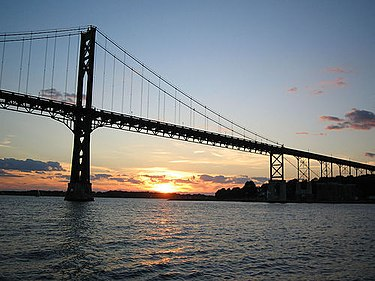 The Mount Hope Bridge is a two-lane suspension bridge spanning the Mount Hope Bay in eastern Rhode Island, at one of the narrowest gaps in Narragansett Bay.  The bridge connects the Rhode Island towns of Portsmouth and Bristol, and is part of Route 114.