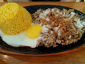 Sisig - A sisig variation in Malolos using mushroom as the main ingredient, served with fried rice and egg.