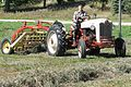 NAA pulling hay rake.jpg