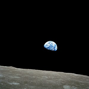 A color photograph of the Earth and Moon on De...