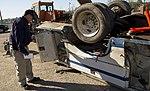 NTSB highway investigator Michael Fox examines truck involved in CA grade crossing accident (16466867269).jpg