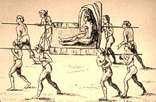 An antique line drawing of a man with a feather crown being carried by eight nearly naked carriers