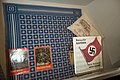 Nazi swastika tablecloth and Hitler pamphlets and books (Besucht Bayern, die heimat Adolf Hitlers, etc.). Münchner Stadtmuseum, Munich, Germany 2014.jpg