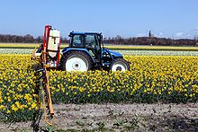 New Holland TL 90 and field sprayer 1.jpg