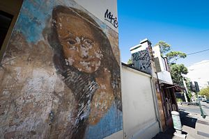 Newtown area graffiti and street art -  Andrew Aiken: Mona Mural Erskinville Rd, Newtown, c1990.