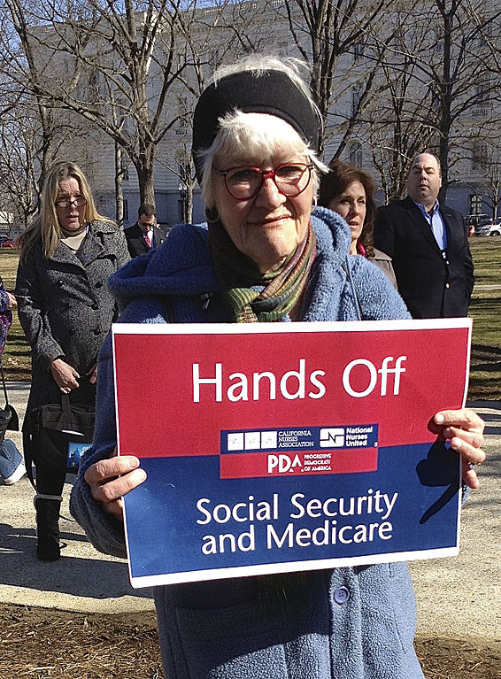 Social Security Disability Pay Chart: Nurse holding red white and blue sign - Hands Off Social ,Chart