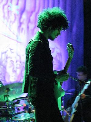 """Entren Los Que Quieran - Puerto Rican-American guitarist Omar Rodríguez-López of The Mars Volta appears on """"Calma Pueblo""""."""