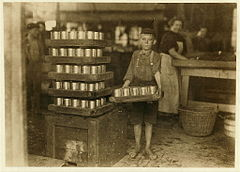 One of the small boys in J. S. Farrand Packing Co. and a heavy load.jpg