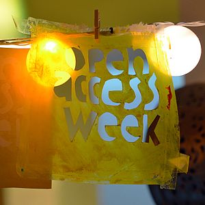 "Open Access Week - A stencil and a card with the text ""Open Access Week"""