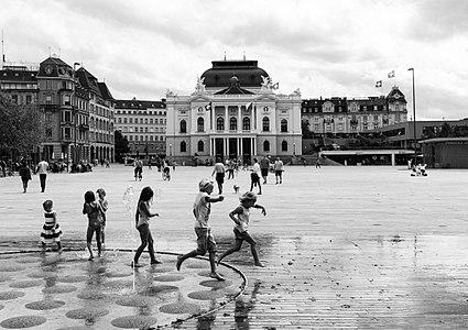 Children in front of the Opera at Sechseläutenplatz in Zürich, Switzerland