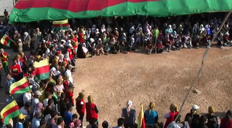 Rojava conflict - PYD supporters at a funeral