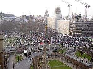 Anti-war protesters gather at Parliament Square on the afternoon of March 20, 2003, as seen from the roof of the Palace of Westminster.