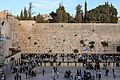 People praying at the Western Wall (12395515865).jpg