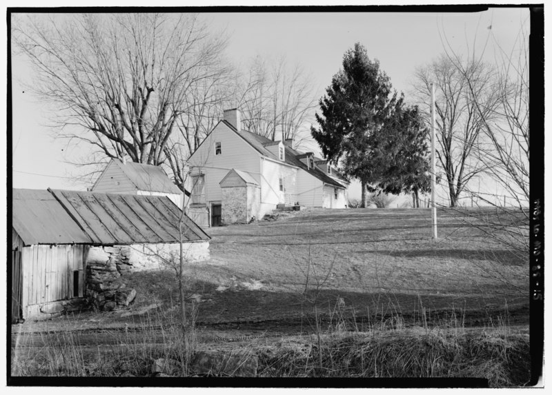 File:Perspective view of west and north elevation, looking southeast; note two outbuildings in foreground. The stone storehouse is in the foreground, and the smokehouse behind it. - HABS MD,22-ANTI.V,1-15.tif