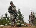 Pfc. Steven Williams, 520th Area Support Medical Company, 56th Multifunctional Medical Battalion, 62nd Medical Brigade, pulls a sled-like litter to transport a casualty while competing for the Expert Field 130410-A-FS521-070.jpg
