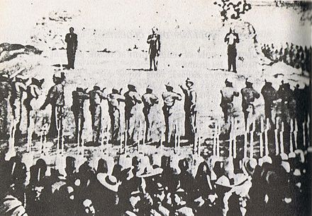 Execution of Mejia, Miramon and Maximilian. While no photograph was taken of the actual execution, an on-the-spot sketch made by eyewitness Francois Aubert indicates that this is an accurate reconstruction Photography of Execution of Maximilian I of Mexico, Miramon and Mejia -- 1867.jpg