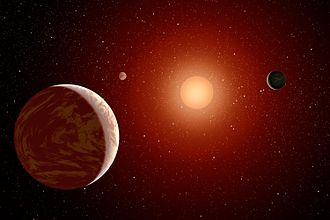 Habitability of red dwarf systems - This artist's concept illustrates a young red dwarf surrounded by three planets.