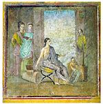 Peintre avec une statue peinte et un tableau. Pompéi
