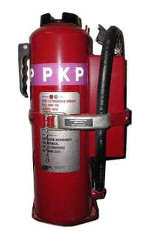 Potassium bicarbonate - A fire extinguisher containing potassium bicarbonate.
