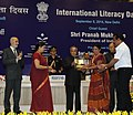 Pranab Mukherjee gave away the Saakshar Bharat awards at the International Literacy Day celebrations, in New Delhi. The Union Minister for Human Resource Development, Smt. Smriti Irani and the Secretary (4).jpg