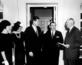 Pelosi and President Kennedy watch as her father is sworn in as a member of the Renegotiation Board, 1961 President John F. Kennedy Attends Swearing-In of Thomas D'Alesandro.jpg