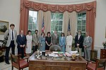 President Reagan having a photo op. in the oval office with White House Photo Office staff including photographers Shaddix, Fitz-Patrick, Fackelman, Souza, Evans, and Kightlinger 1983-06-21.jpg