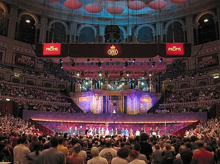 A promenade concert in the Royal Albert Hall, 2004. The bust of Sir Henry Wood can be seen in front of the organ. Proms-albert-hall-04.jpg