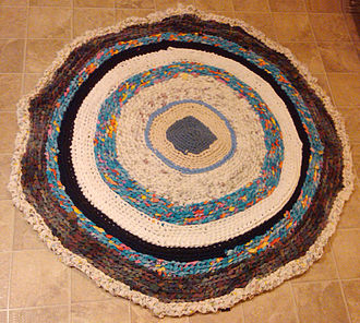Rug making - Rag rug constructed from T-shirts and bed linens
