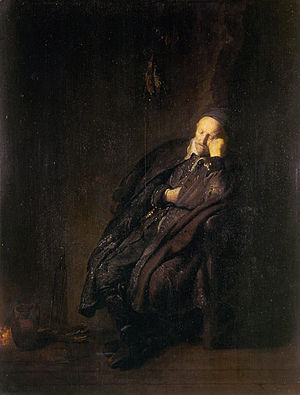 An old man sleeping near the fire