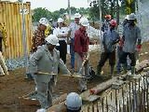 Arlene Render - Former Ambassador Render shovels the first dirt from the site of the new US Embassy in Abidjan.