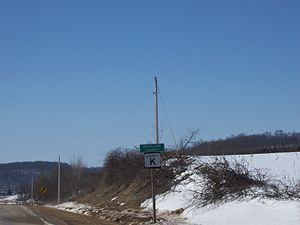 Richland County, Wisconsin - Sign marking entrance into Richland County, with countryside in background