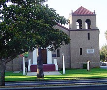 Exterior view of the mission revival style Riverside Baptist Church building in Riverside, California