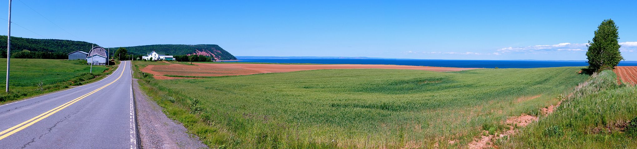 Eastern End. Road leading to Blomidon Provincial Park with the Minas Basin in view to the right.