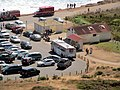 Rodeo Beach parking lot with Muni route 76X bus, August 2017.JPG