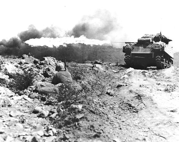 An M4 Sherman tank equipped with a flamethrower clearing a Japanese bunker on Iwo Jima, March 1945. Ronson flame tank Iwo Jima.jpg