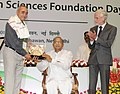 S. Jaipal Reddy presented awards, at the Foundation Day Function of Ministry of Earth Sciences, in New Delhi on July 27, 2013. The Director, Grantham Institute for Climate Change, Prof. Sir Brian Hoskins is also seen.jpg