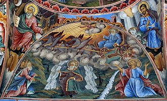 Saint Elias in the cave (below) and on a chariot of fire. A fresco from Rila Monastery, Bulgaria, medieval Orthodox tradition, renovated 20th century SaintIliaFromRilaMonastery.jpg