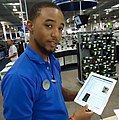 Salesperson at Best Buy demonstrating Apple IPad.jpg