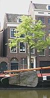 foto van Koopmanshuis van parterre en twee verdiepingen met zadeldak