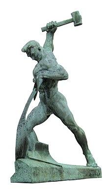 Skulptur: Mann mit Hammer.