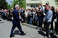 Secretary Kerry Walks Over to Greet Onlookers After Visiting the Zavokzalny War Memorial.jpg