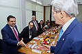 Secretary Kerry greets Executive Chairman Adani before meeting with Indian CEOs amid Vibrant Gujarat Summit.jpg