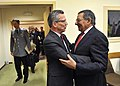 Secretary of Defense Leon E. Panetta embraces German Defense Minister Thomas de Maiziere as he attends meetings at NATO headquarters with fellow defense counterparts in Brussels.jpg