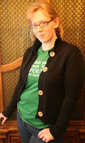 Cardigan (sweater) - A woman, wearing a cardigan sweater. A popular style in the U.S.