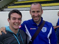Shaun Derry with a fan during Pre-Season 2011.jpg
