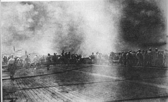 Japanese aircraft carrier Shōkaku - Shōkaku crewmembers fight fires on the flight deck after being hit by American bombs during the Battle of the Santa Cruz Islands