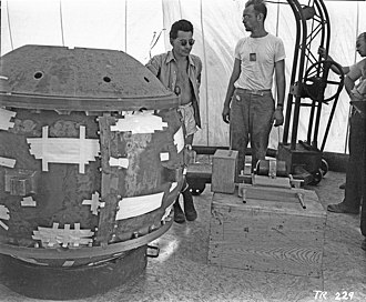 Trinity (nuclear test) - Louis Slotin and Herbert Lehr with the Gadget prior to insertion of the tamper plug (visible in front of Lehr's left knee)